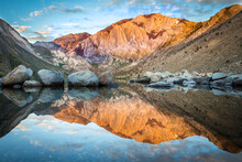 Still Waters Of Convict Lake, California At Sunrise Reflect The Mountains In Distant John Muir Wilderness In Inyo National Forest