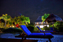 A Starry Night View Of A Deck Chair And A Villa At Villas Flamingos Hotel On Holbox Island, Mexico.