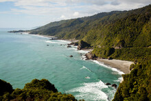 Surf Crashes On A Remote Beach Near Dolomite Point Next To Highway 6 In New Zealand's South Island.