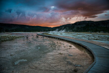 Evening Storm Clouds Gather Over Biscuit Basin In Yellowstone National Park.