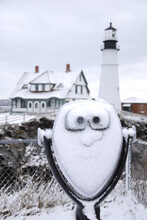 Snow Covered Viewer Looks Like A Face With A View Of Portland Headlight In The Background, Cape Elizabeth, Maine
