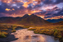 A Small Tributary Of The Yukon River Leading To Epic Sunset Light In The Foothills Of The Tombstone Range, Yukon Territory.
