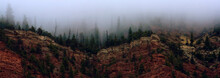 The Red Sandstone Cliffs Of Bellyache Ridge Covered In Fog During Late Fall In Wolcott Colorado.
