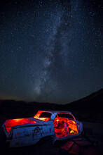 Light Painted Abandoned Impala Vehicle In The Nevada Desert Outside Death Valley National Park With Milky Way Above. Located Near Beatty, Nevada.