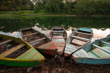 Colorful Fishing Boats Line The Shore Of Lake Yojoa In Honduras.
