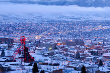 Cold December Morning In Uptown Butte, Montana. The Neighborhood Surrounding The Headframe Of The Anselmo Mine Sits Under It's Neon Glow.