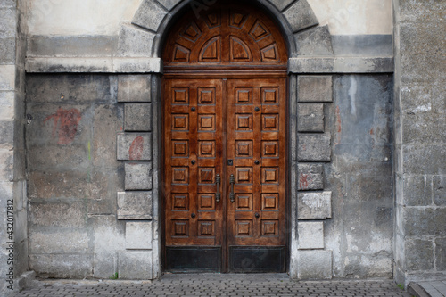 Old facades of a gothic building, doors and windows Fotobehang