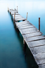 A Long Exposure Shot Of A Rickety Old Dock
