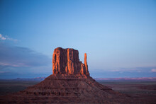 Sunset On The Buttes At Monument Valley. One Of The Mitten Buttes And Merrick Butte.
