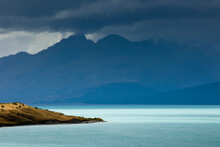 A Rainstorm Clears From Aoraki / Mt. Cook National Park Revealing The Aqua-colored Glacial Melt Of Lake Pukaki And The Rugged Peaks Of The Southern Alps In New Zealand's South Island.