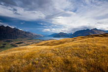 The Remarkables And Eyre Mountains Rise Sharply Above Lake Wakatipu After A Rainstorm As Seen From Kelvin Heights Near Queenstown, New Zealand's South Island.