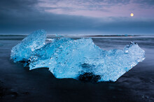 Detailed Image Of Iceberg On The Black Sand Beach, Under A Dramatic Sky At Jokulsarlon, Iceland.