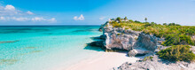 Turquoise Blue Waters, Dramatic Limestone Cliffs, And Powder Soft White Sand Beach At Lighthouse Point On The Island Of Eleuthera, The Bahamas