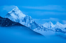 Fog Sweeps Down The Khumbu Valley In Front Of Ama Dablam Near The Village Of Lobuche In Nepal.