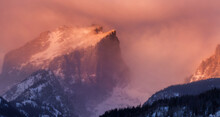 Hallet Peak, In Rocky Mountain National Park, At Sunrise As A Winter Snowstorm Is Beginning To Affect The Mountains Along The Front Range.