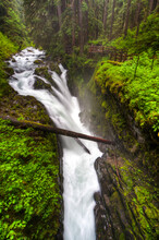 Olympic National Park, WA: Water Flowing Over Rocks Creating The Sol Duc Falls.