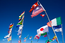 Flags Of Many Nations Flutter In The Wind In The Salar De Uyuni On Bolivia's Altiplano.