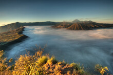 A Sea Of Clouds Covers The Caldera At Sunrise In Bromo-Tengger-Semeru National Park On The Island Of Java In Indonesia