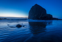 Haystack Rock In Cold Winter Dusk Blues At Cannon Beach