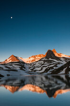 Ice Lake Basin, CO: The Moon Hangs In The Sky As The Morning Alpenglow Reflects Off Of Ice Lake
