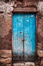 A Rustic Old Door Set In Mud Brick In Torotoro, Bolivia.