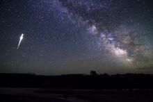 A Large Eta Aquariid Meteor Streaks Across The Night Sky Above Jackson Hole, Wyoming.