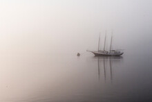 St. Mary's, Georgia: A Sailboat Is Moored On The River Just Outside The Cumberland National Seashore Ferry During A Early Foggy Morning