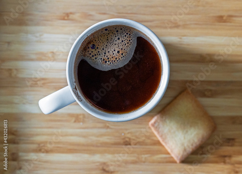 Obraz cup of black coffee and cookie - fototapety do salonu