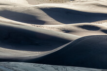 Ridges Of Sand At Sunrise In Great Sand Dunes National Park, Colorado.