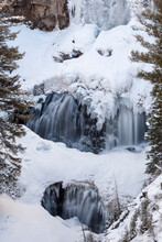 Ice Forms Around Undine Falls During Winter In Yellowstone National Park, Wyoming.