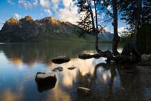 Jenny Lake Reflects Sunrise On The Teton Mountains In Grand Teton National Park, Wyoming.
