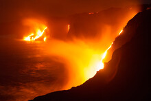 Lava From The Kilauea Volcano On The Big Island Of Hawaii Pours Over Cliffs Into The Pacific Ocean.