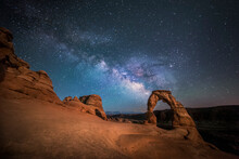 The Milky Way Shines Over Delicate Arch At Arches National Park (Utah, USA).