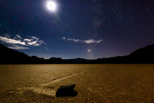 A Quarter Moon Illuminates One Of The Many Rocks On The Racetrack Playa In Death Valley CA