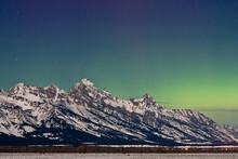 Northern Lights, Aka The Aurora Borealis, Light Up The Sky Behind The Teton Mountains In Grand Teton National Park, Wyoming.