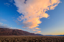 Pre Sunset Clouds Light Up Above Devil's Golf Course In Death Valley National Park, CA.