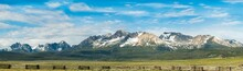 The Sawtooth Mountain Range With A Fence In The Foreground