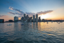 The Boston Skyline From Boston Harbor At Sunset.