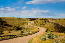 A Winding Paved Road & Panoramic Views Of Dinosaur National Monument In NW Colorado During Summer.