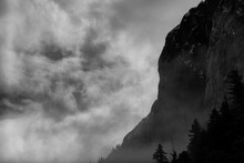 Clouds Drift Through The Mountains In The Valley Of Yosemite National Park.