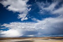 On A Bus To Puno, Peru Near Lake Titicaca, Storm Clouds And A Yellowish Plain.