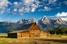 The Moulton Barn Rests Below The Teton Mountains In Grand Teton National Park, Wyoming.