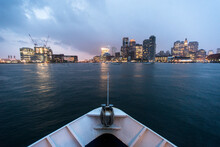 The Boston, MA Skyline As Viewed From A Ship In The Harbor On A Rainy Summer Evening.