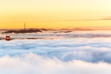 The Golden Hour At The Golden Gate Bridge With Heavy Fog Sweeping Into The San Francisco Bay, USA