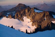 Sunset On Nearby Mountains Below Eldorado Peak, North Cascades National Park, Washington.