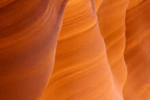 An Abstract View Of The Sandstone Edges And Lines Accentuated By Reflected Light In A Remote Slot Canyon Of The Arizona Desert.