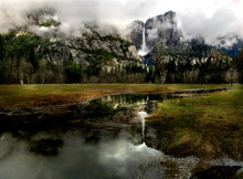 A Reflection Of Snow And Water Shows In The Valley Of Yosemite National Park.