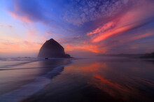 Sunset Over Haystack Rock, Cannon Beach, Oregon, USA.