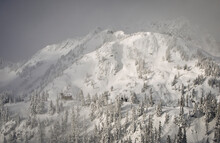A Winter Storm Breaks Long Enough To See The Top Of Pan Dome And Mount Herman Beyond From Chair At Mount Baker Ski Area.