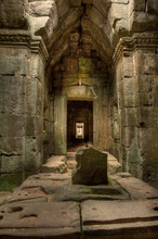 A Hallway Inside One Of The Many Temples Located At Angkor In Cambodia
